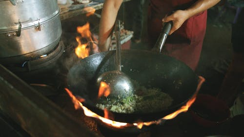 Deep Frying A Crab On A Wok In High Fire